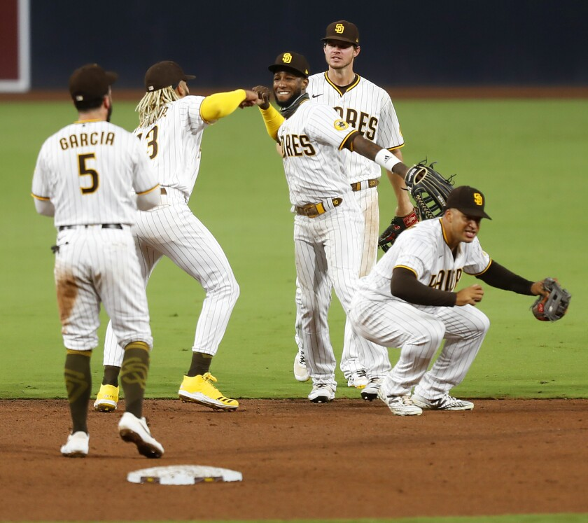 The San Diego Padres celebrate a 7-2 win over the Los