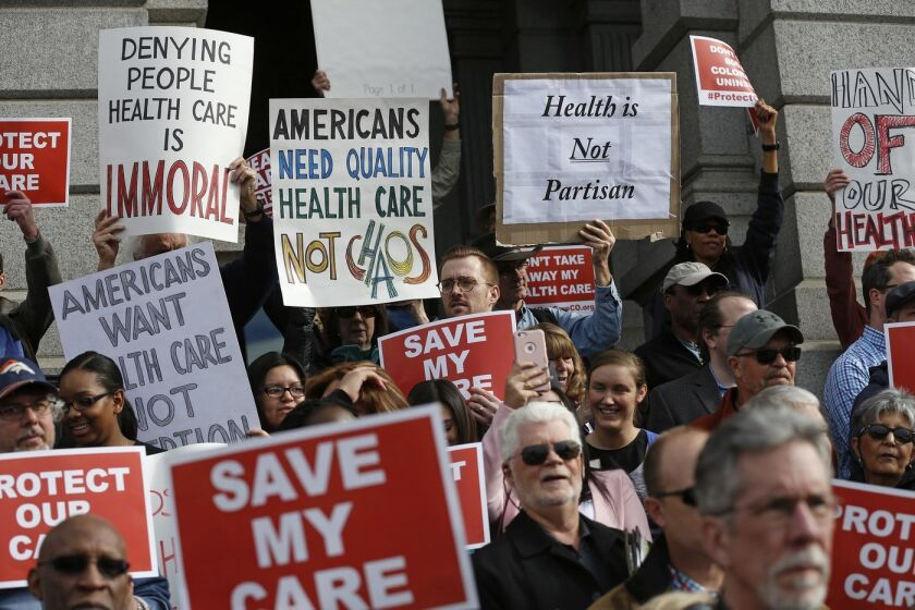 Demonstrators in Denver call for preservation of the Affordable Care Act in 2017.