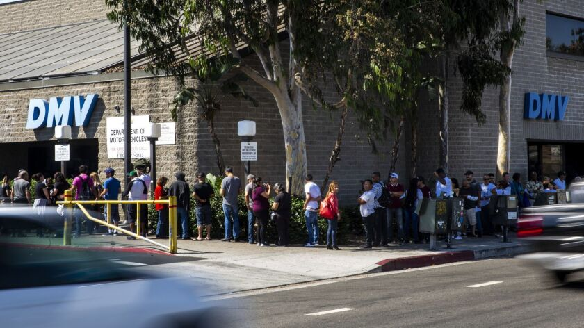 People wait to be helped at the South L.A. DMV office on Aug. 7.