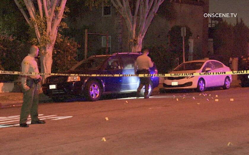 Five people were hospitalized following a shooting May 26 outside a South Los Angeles apartment complex.