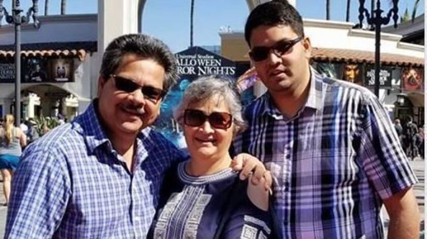 Russell French, left, Paola French and son, Kenneth. Kenneth was shot and killed by an off-duty police officer in 2019.