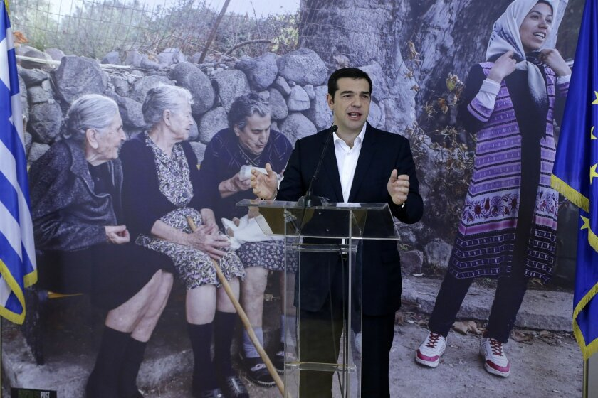Greece's Prime Minister Alexis Tsipras makes statements, after the first 30 refugees to be relocated from Greece have boarded a plane in Athens bound for Luxembourg on Wednesday, Nov. 4, 2015. The six families from Syria and Iraq who left Greece on Wednesday mark the start of a program seeking to r