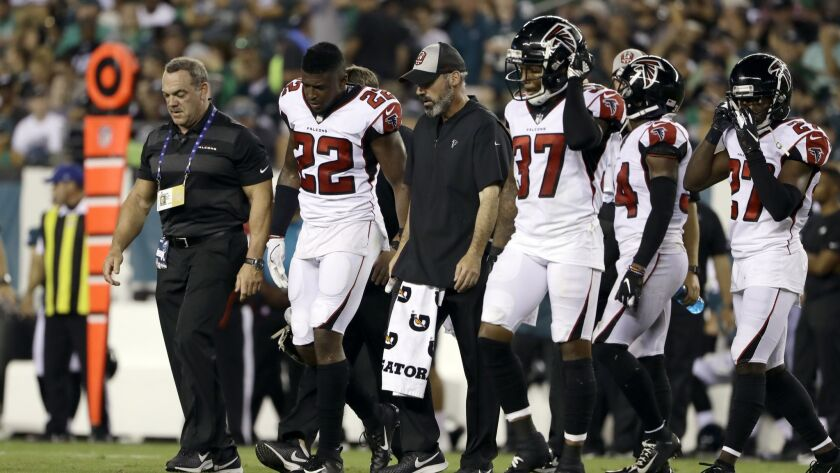 Atlanta Falcons' Keanu Neal (22) is helped off the field during the second half against the Philadelphia Eagles.