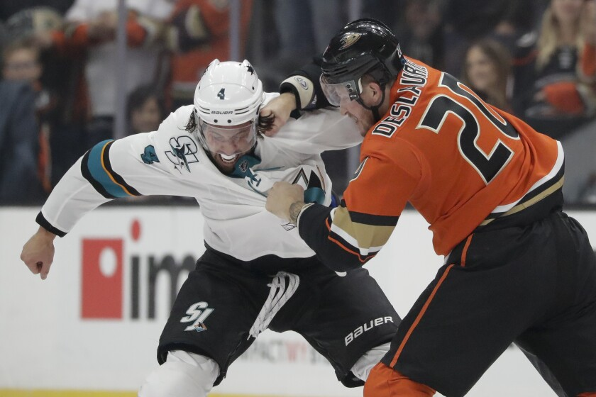 Anaheim Ducks left wing Nicolas Deslauriers, right, hits San Jose Sharks defenseman Brenden Dillon during the first period of an NHL hockey game in Anaheim, Calif., Saturday, Oct. 5, 2019. (AP Photo/Chris Carlson)