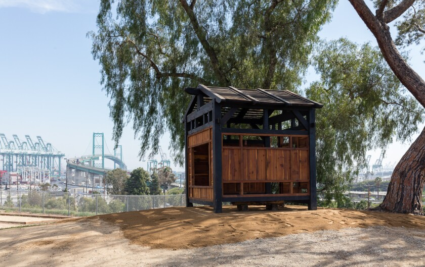 After mysteriously materializing in Griffith Park last summer, the Griffith Park Teahouse went up in San Pedro on Monday — this time, with permission from the city.