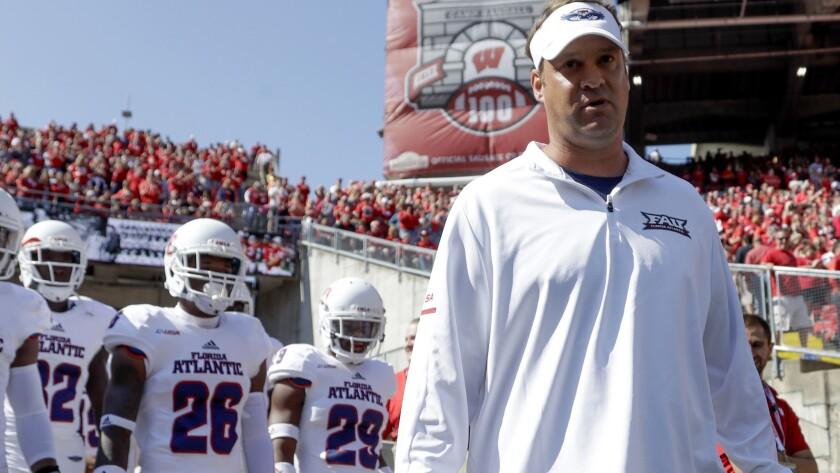 Florida Atlantic head coach Lane Kiffin leads his team on the field before an NCAA college football