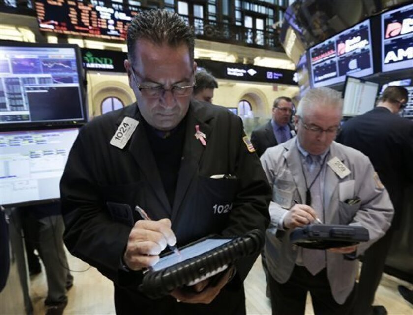 In this Tuesday, April 16, 2013, photo, traders John Yaccarine, left, and James Dresch wortk on the floor of the New York Stock Exchange. World stock markets were pushed higher Wednesday May 8, 2013 by an improvement in China's trade and yet another record-busting session on Wall Street. (AP Photo/Richard Drew)