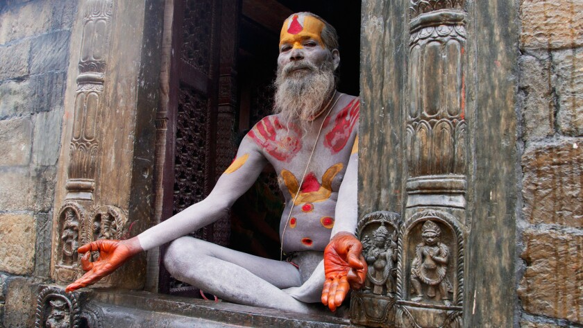 """Ralph Velasco took this photo in Nepal while on a scouting trip for a future tour for his clients. He says, """"Pashupatinath Temple is the most sacred Hindu shrine in Nepal and located on the Bagmati River. This man is a 'sadhu,' or self-proclaimed holy man (sadhu is Sanskrit for 'good man')."""""""