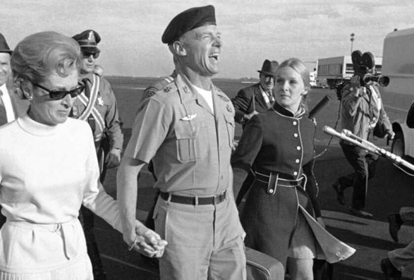 Col. Robert Rheault is accompanied in October 1969 by his then-wife, Caroline Anna Young, and daughter Susanne at Logan International Airport in Boston.