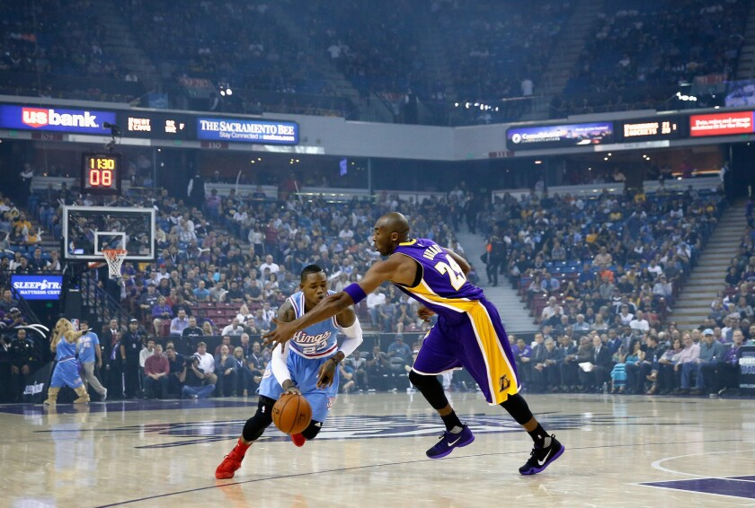 Sacramento's Ben McLemore is fouled by the Lakers' Kobe Bryant at Sleep Train Arena on Friday.