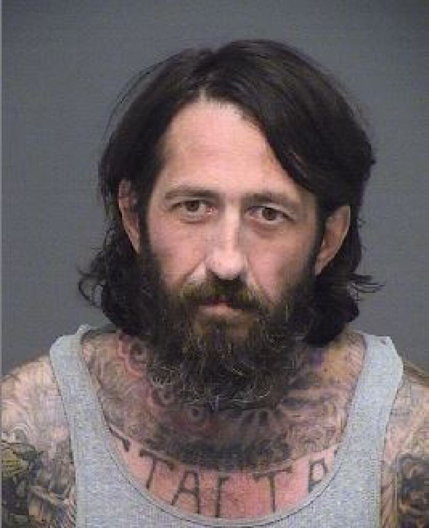 Man carrying cash, drugs, ski mask and loaded gun arrested in Huntington Beach, police say