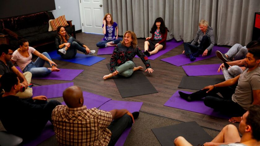 Acting teacher Elizabeth Mestnik, center, begins class with a yoga sequence of breath and movement exercises, at her studio.