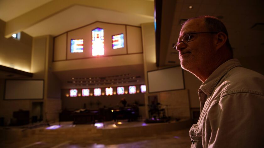 Senior pastor Jack Matkin leads the recovery effort as volunteers ready the main sanctuary space dam