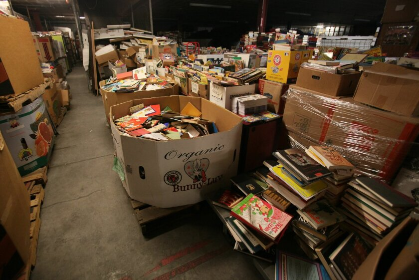 Pallets, boxes and shelves of books in the San Diego Book Project's East Village warehouse.