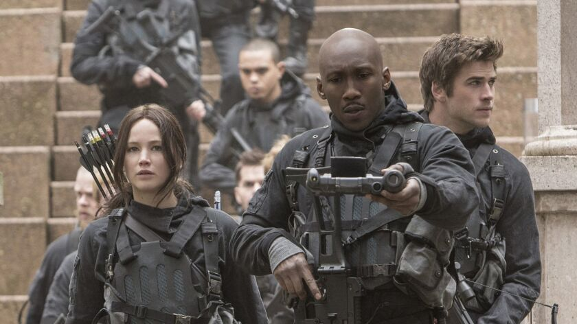 This image released by Lionsgate shows Jennifer Lawrence as Katniss Everdeen, from left, Mahershala