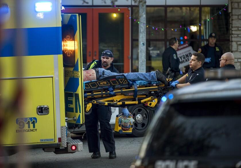 Paramedics transport a stabbing victim in Austin, Texas, on Friday, Jan. 3, 2020. (Jay Janner/Austin American-Statesman via AP)