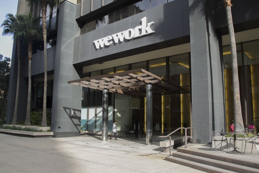 A delay or cancellation of SoftBank's offer to buy stock in WeWork would cut off a source of income many former and current WeWork employees had been counting on.