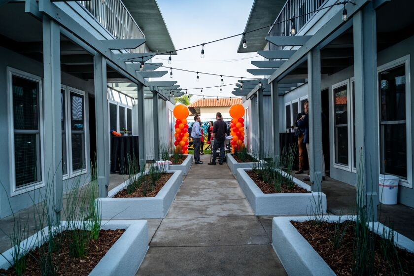 The nonprofit Families Forward celebrates a renovated affordable residence in Costa Mesa in 2019.