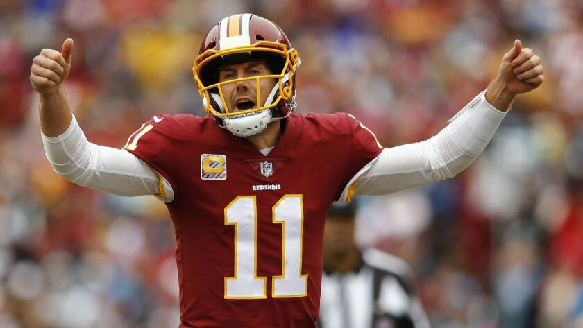 Redskins quarterback Alex Smith, a Helix High School graduate, guides a drive Sunday against the Panthers at FedEx Field in Landover, Md.