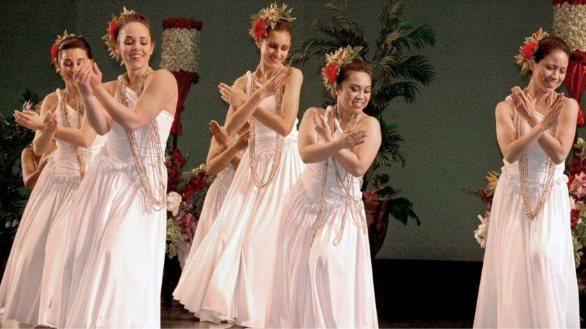 Members of the dance school, Hula Halau Na Mamo O Pana'Ewa perform during the show last May. The nex