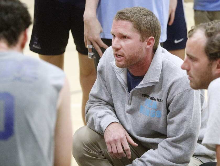 Corona del Mar's head coach Sam Stafford talks with his team during a timeout against Loyola in a no