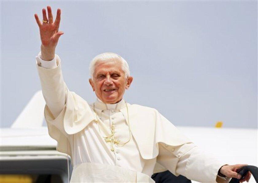 Pope Benedict XVI greets the crowd upon his arrival to Zagreb airport, Croatia, Saturday, June 4, 2011. Pope Benedict XVI is on a two-day visit to Croatia. (AP Photo/Damir Sencar, Pool)