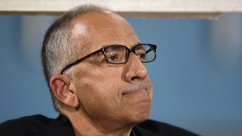Carlos Cordeiro, vice president of U.S. soccer, watches warmups from the team bench ahead of the start of the U.S. men's World Cup qualifying match against Trinidad and Tobago.