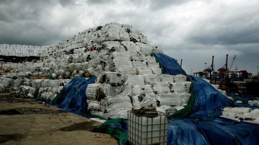 Piles of trash stacked at the port of Beirut, the Lebanese capital, are the result of a years-long garbage crisis.