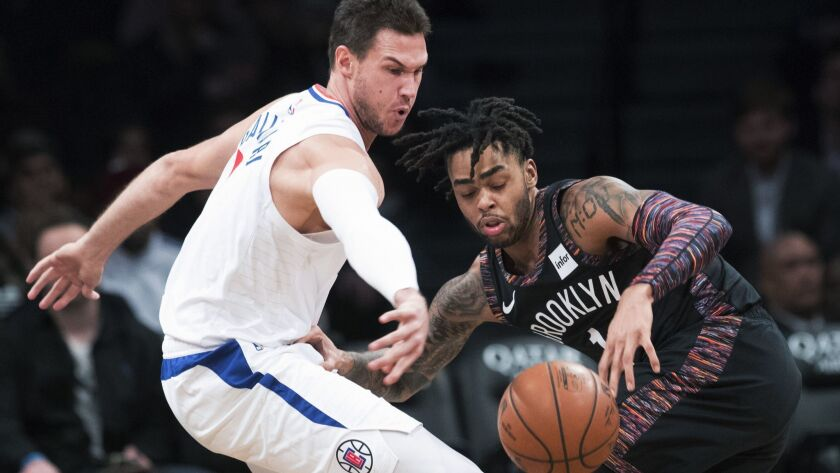 Clippers forward Danilo Gallinari strips the ball from Nets guard D'Angelo Russell (1) during the first half Saturday.