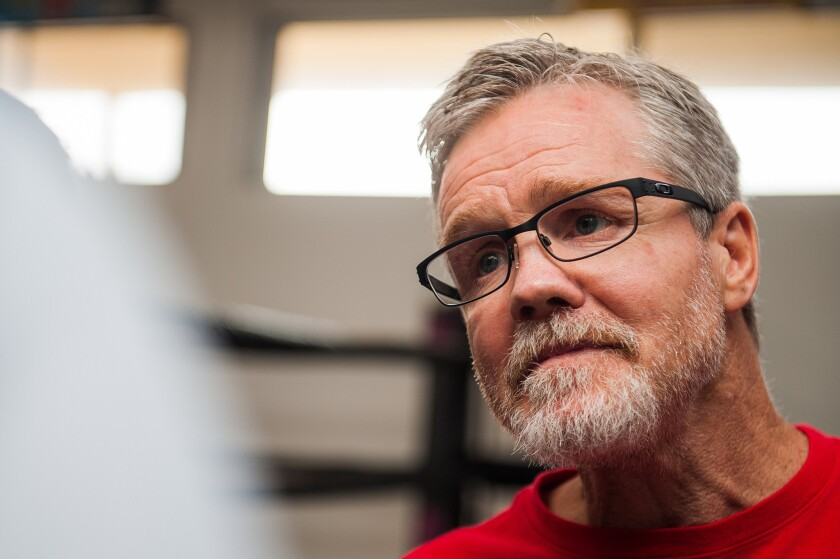 Boxing trainer Freddie Roach talks with the media before a workout session in Hollywood.