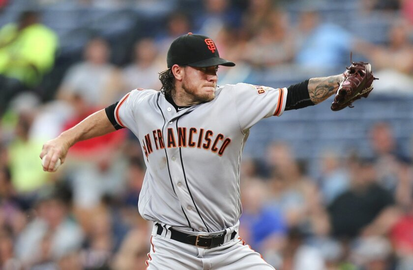 San Francisco Giants starting pitcher Jake Peavy delivers a pitch during the sixth inning of a baseball game against the Atlanta Braves on Tuesday, May 31, 2016, in Atlanta. (AP Photo/John Bazemore)