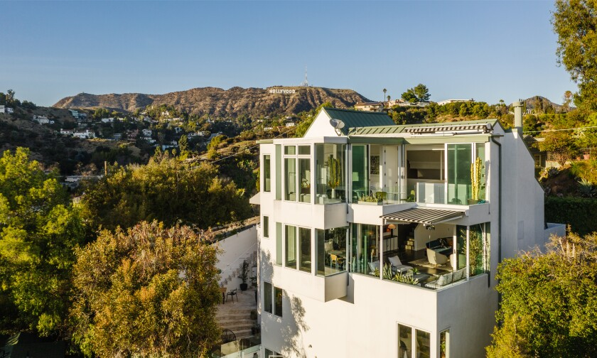 Diplo's four-story, 2,500-square-foot home takes advantage of the setting with walls of glass and multiple terraces.