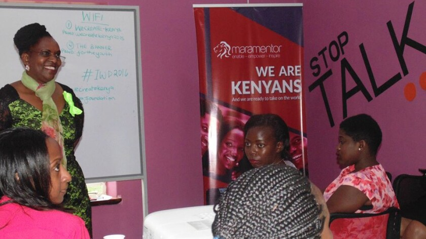 Kenyan politician Gladys Chania, standing, encourages women to pursue leadership positions and mentor others during a U.N. women's forum dubbed Pledge for Parity.