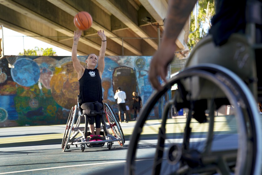 In her teens, Megan Blunk struggled with depression even before she became paralyzed from the waist down in a motorcycle accident. She found hope and a a future playing wheelchair basketball, first in college and then for the Team USA on a gold medal-winning team in the Paralympics. She's now the first and only woman on the Wolfpack, an all-men's military wheelchair basketball team. On Tuesday October 8, 2019 she and two other Wolfpack team members went through a workout at Chicano Park in San Diego.