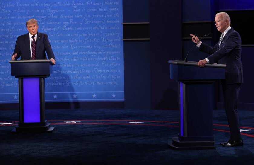 President Trump and former US Vice President Joe Biden speak during their first debate in Cleveland, Ohio, on Tuesday.