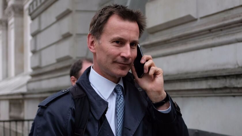 British Health Secretary Jeremy Hunt arrives at Downing Street in central London on Monday.