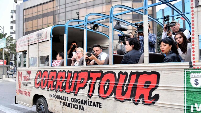 """Journalists and tourists are pictured on board of the """"Corruptour"""", a bus that offers a sightseeing"""