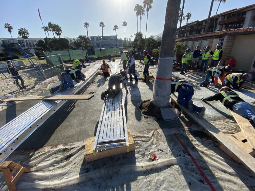 Workers from Shaw & Sons Conrete pour and pave thousands of pounds of concrete for The Map of the Grand Canyons of La Jolla Educational Plaza in Kellogg Park, February 2020.