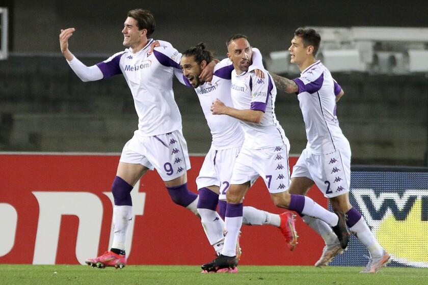 Fiorentina's Martin Caceres, second left, celebrates a goal penalty 0-2, during the Italian Serie A soccer match between Hellas Verona and Fiorentina at Stadio Marcantonio Bentegodi, in Verona, Italy, Tuesday, April 20, 2021. (Paola Garbuio/LaPresse via AP)