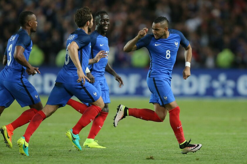 France's Dimitri Payet, right, celebrates with teammates after scoring the third goal during a friendly soccer match between France and Cameroon at the La Beaujoire Stadium in Nantes, western France, Monday, May 30, 2016. The French squad is in preparation for the EURO 2016 soccer championships whi