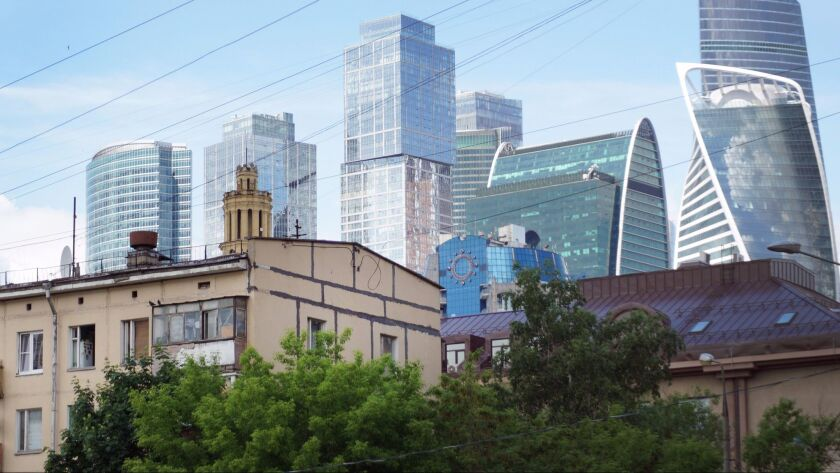 A controversial plan to knock down Soviet-era apartment blocks, like these dwarfed by modern skyscra