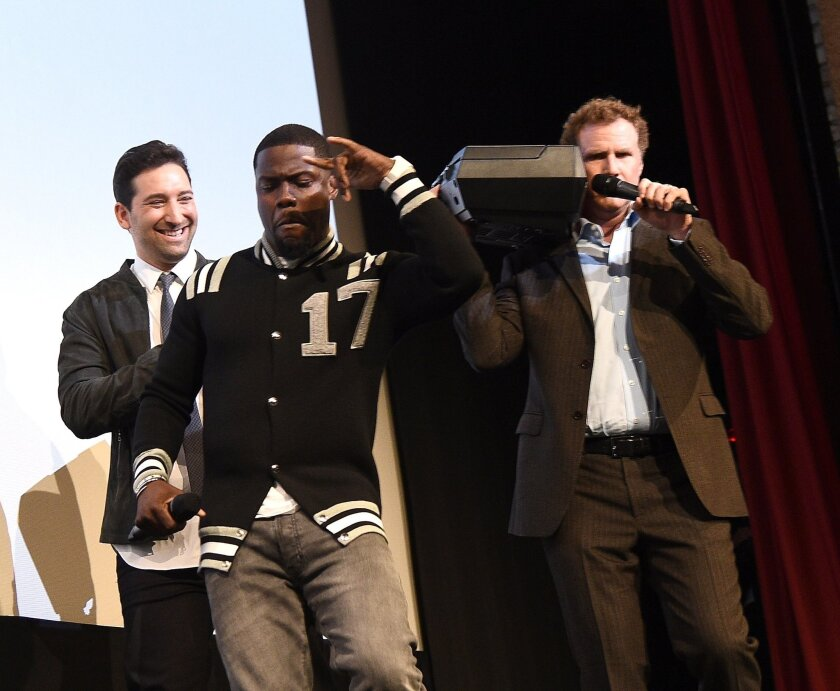 "Director Etan Cohen, from left, Kevin Hart and Will Ferrell rev up the crowd at the SXSW premiere of ""Get Hard."""