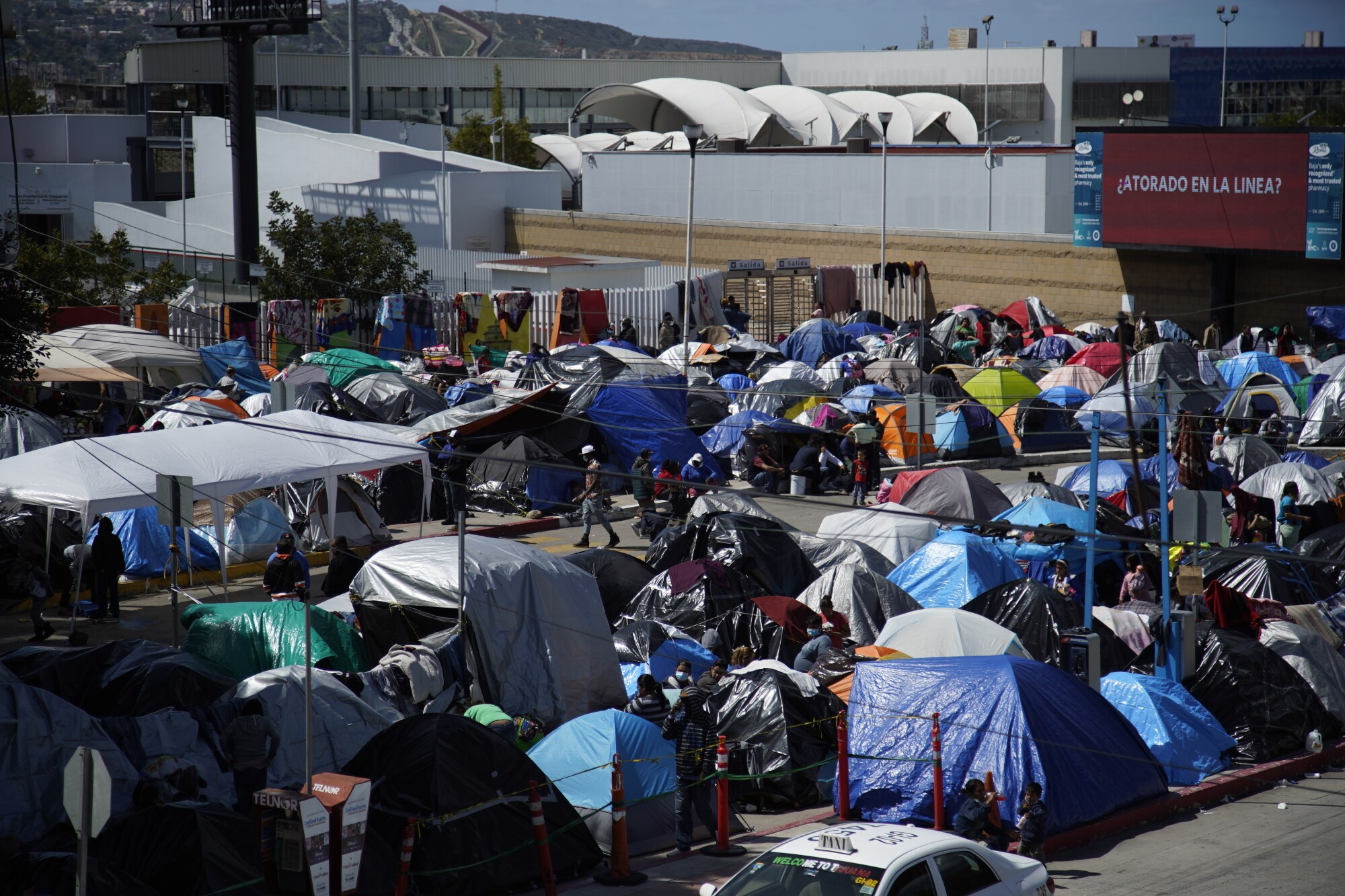 Hundreds of asylum seekers have set up camp by the port of entry at Tijuana's Chaparral plaza.