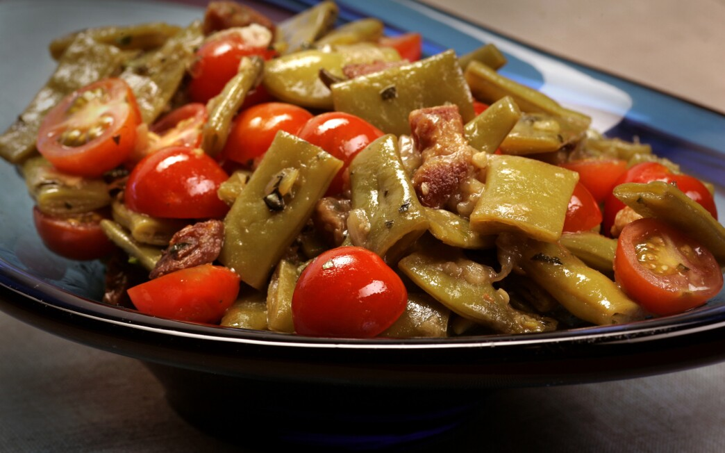 Braised Romano beans with pancetta and cherry tomatoes