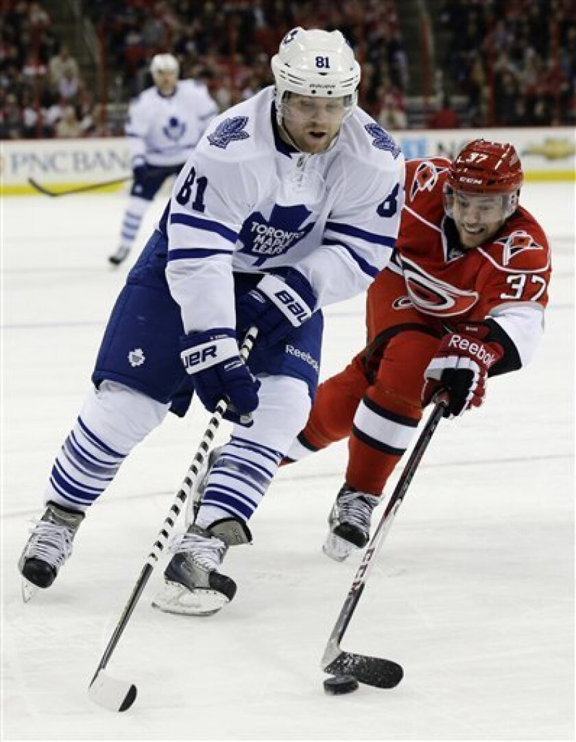 Carolina Hurricanes' Tim Brent (37) chases Toronto Maple Leafs' Phil Kessel (81) during the first period of an NHL hockey game in Raleigh, N.C., Thursday, Feb. 14, 2013. (AP Photo/Gerry Broome)