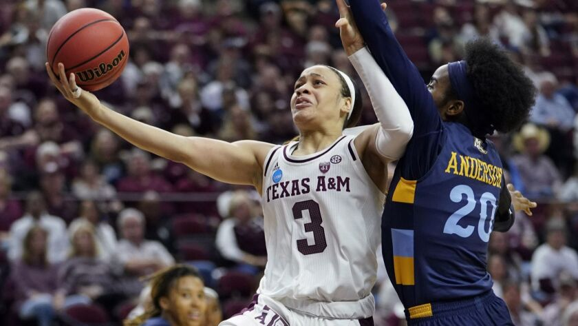 Texas A&M's Chennedy Carter (3) goes up for a shot as Marquette's Altia Anderson (20) defends during