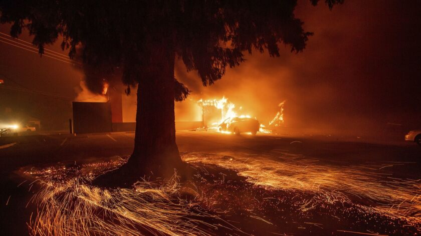Flames consume a fast food restaurant as the Camp Fire tears through Paradise, Calif., on Thursday,