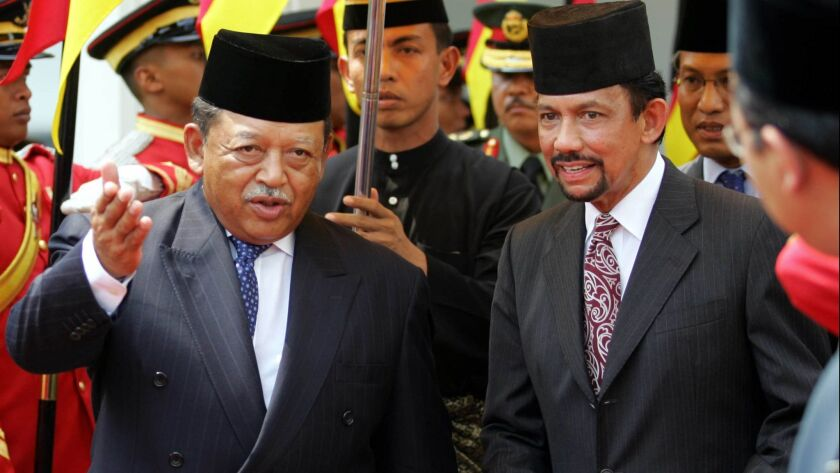 Brunei's Sultan Hassanal Bolkiah (R) is