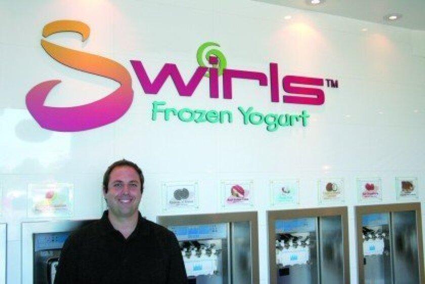 Owner Evan Wilensky gives customers their frozen yogurt fix at Del Mar Swirls, Encinitas Swirls and Carmel Valley Swirls. Photo by Karen Billing