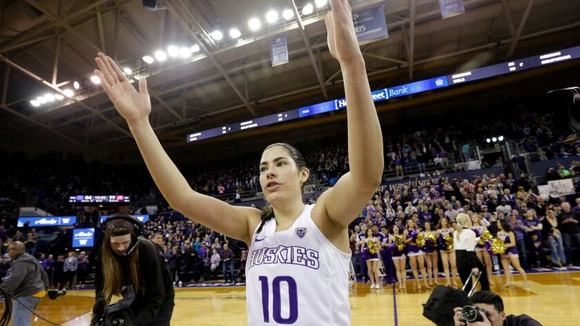 Washington's Kelsey Plum waves to fans after setting NCAA scoring record.